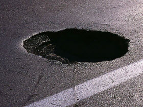 Pothole photo. By Flikr user councildistrictfour.