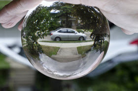 Car in crystal ball. Photo by Flikr user lisa cee (Lisa Campeau).