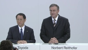 Toyota president Akio Toyoda and Norbert Reithofer, CEO of BMW, together at a joint press conference in Munich. Image from Toyota Global's livestream of the press conference.