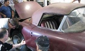 Enthusiasts check out the No. 1 Cunningham Corvette inside Larry Miller's garage. Photo by Dale Jewett.
