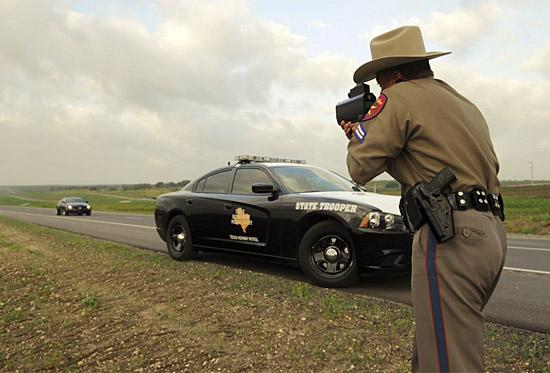 A Texas State Trooper clocks John Hennessey on the new Texas SH 130. (c) Hennessey