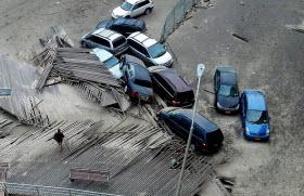 Hurricane damaged cars. Photo by Flikr user iakoubtchik.