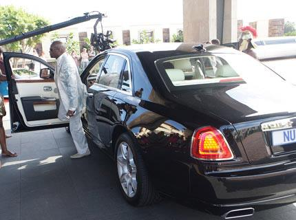Sibusiso Mpisane arrives to a party in his Rolls-Royce Ghost (c) Howzit MSN
