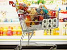Image: Full Shopping Cart in Grocery Store © Fuse/Getty Images