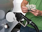 Image: Buying gas (© moodboard/Corbis/Corbis)