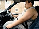 Fat driver: Image: Smoking and driving (© Digital Vision/Getty Images)