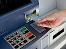 Image: Cash machine (&#169; Compassionate Eye Foundation/Getty Images/Getty Images)