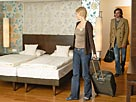 Image: Couple Entering a Hotel Room &#169; Fuse/Getty Images