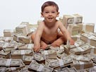 Image: Baby with money (&#169; Creatas/Photolibrary)