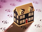 Image: Miniature home on sheet of percent signs© Comstock/Getty Images