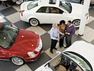 Image: Couple shopping for car (© Don Mason/Blend Images/Corbis)