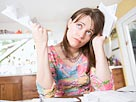 Image: Woman with paperwork (© Big Cheese Photo/Jupiterimages)
