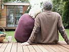 Image: Couple sitting on deck in backyard (&#169; Sam Edwards/OJO Images/Getty Images)