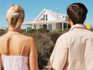 Image: Rear view of a mid adult couple holding hands looking at a house (© Stockbyte/Getty Images)