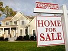 Image: Home with foreclosure sign in front yard &#169; Ariel Skelley/Stockbyte/Getty Images