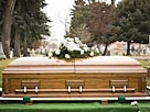 Image: Coffin at a cemetery (© Mike Kemp/the Agency Collection/Getty Images)