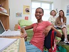 Image: Student in dorm room (© James Woodson/age fotostock)