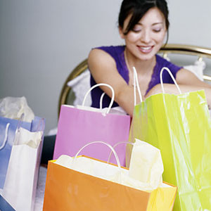 Image: Woman with shopping bags © Tanya Constantine, Getty Images