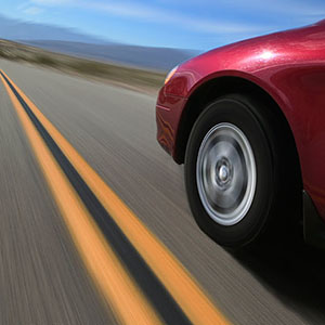 Image: Car on road. Copyright: Brand X, SuperStock