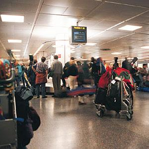 Image: Airport baggage claim. Copyright: Digital Vision, Getty Images
