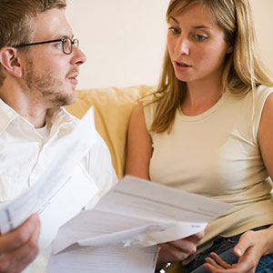 Image: Couple with paperwork (&#169; Christina Kennedy/Brand X/Corbis)