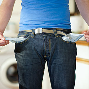 Image: Man holding out empty pockets. (&#169; Dougal Waters/Photodisc/Getty Images)