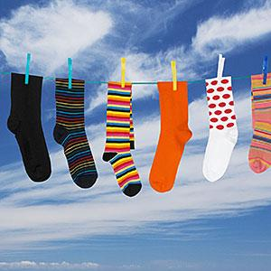 Image: Various socks hanging on washing line &#169; Dolding Productions Ltd, Digital Vision, Getty Images