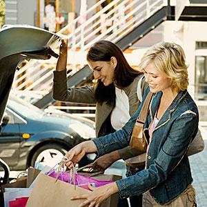 Image: Two young women putting shopping bags in car © Dan Dalton, Digital Vision, Getty Images