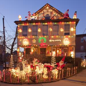 A house decorated with many Christmas lights (© Steve Dunwell/Photographer's Choice/Getty Images)