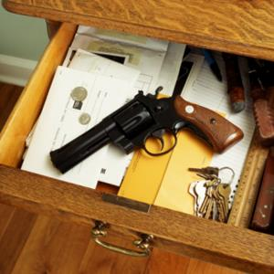Revolver in open dresser drawer (&#169; David McGlynn/Photographer's Choice/Getty Images)