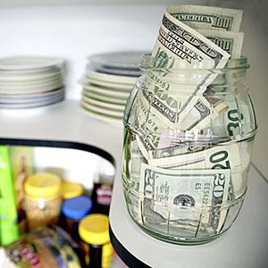 Image: U. S. banknotes on shelf in kitchen pantry © Supapixx, Alamy
