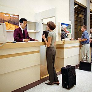 Image: Customers Checking in Car Rental Agency &#169; Lawrence Manning, Corbis
