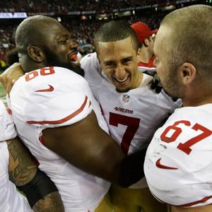 San Francisco 49ers' Colin Kaepernick (7) celebrates with Leonard Davis and Daniel Kilgore after the NFL football NFC Championship game (© Dave Martin/AP Photo)
