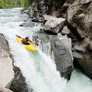 Image: A kayaker descending a creek in the San Juan National Forest in Colorado &#169; Kennan Harvey, Aurora Open, Getty Images