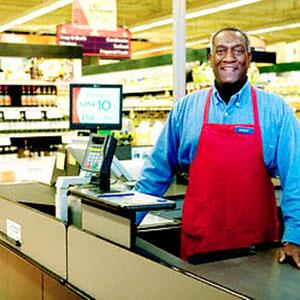 Image: Grocery clerk (&#169; Royalty-Free/Corbis)