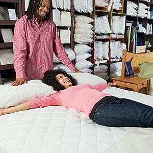 Image: Couple shopping for beds &#169; Tanya Constantine, Blend Images, Getty Images