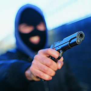 Image: Criminal with gun &#169; Flying Colours Ltd, Digital Vision, Getty Images