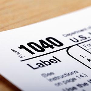 Image: US government 1040 tax form © Steven Puetzer/Photographer