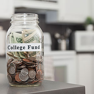 Image: College fund stored in glass jar in kitchen &#169; Vstock LLC, Tetra images, Getty Images