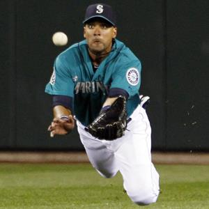 Seattle Mariners center fielder Franklin Gutierrez dives for a fly ball during a game on Sept. 7, 2012, in Seattle (© Elaine Thompson/AP Photo)