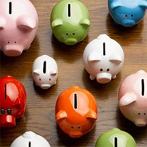 Multi-colored ceramic piggy banks &#169; Andy Roberts, OJO Images, Getty Images