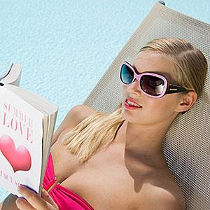 Image: Woman reading book on sunlounger on vacation &#169; Image Source/Image Source/Getty Images