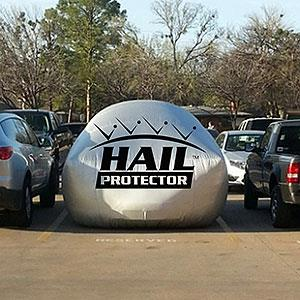 Hail protector between two vehicles (courtesy Hail Storm Products LLC)