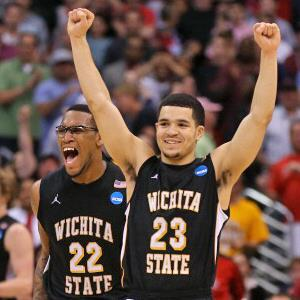 Fred Van Vleet #23 and Carl Hall #22 of the Wichita State Shockers celebrate after defeating the Ohio State Buckeyes 70-66 during the West Regional Final of the 2013 NCAA Men's Basketball Tournament at Staples Center on March 30, 2013 in Los Angeles (© Jeff Gross/Getty Images)