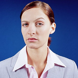 Logo: Skeptical woman (Image Source/age fotostock)