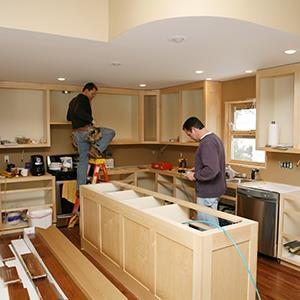 Men remodeling a kitchen (© George Peters/E+/Getty Images)