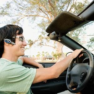 Man using hands-free phone ( Digital Vision Ltd./Getty Images)