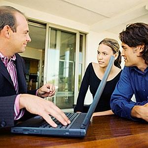  Couple meeting financial adviser  Image Source, Getty Images