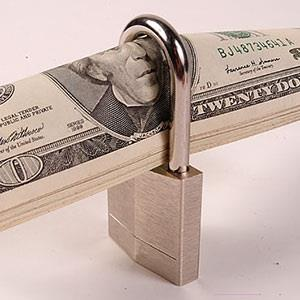 Image: Money with lock &#169; Ingram Publishing, SuperStock