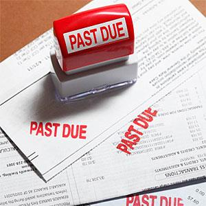 Logo: Past due stamp sitting on three bills. (Derek E. Rothchild, Stockbyte, Getty Images)